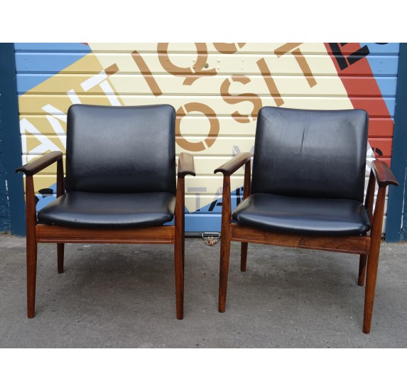 Pair of Finn Juhl rosewood Diplomat chairs