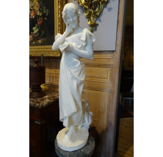 Tall white marble sculpture of Ezio Ceccarelli, young girl with the letter