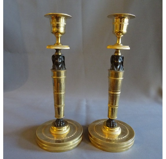 Pair of Empire period candlesticks, return from Egypt