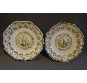Pair of Moustiers earthenware medallion plates