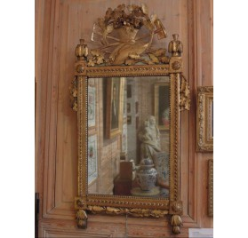 Mirror with gardener's tools in gilded and carved wood, Louis XVI period