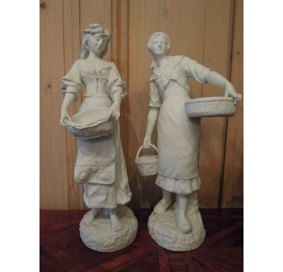 Pair of white china signed G. Levy : young peasant girls