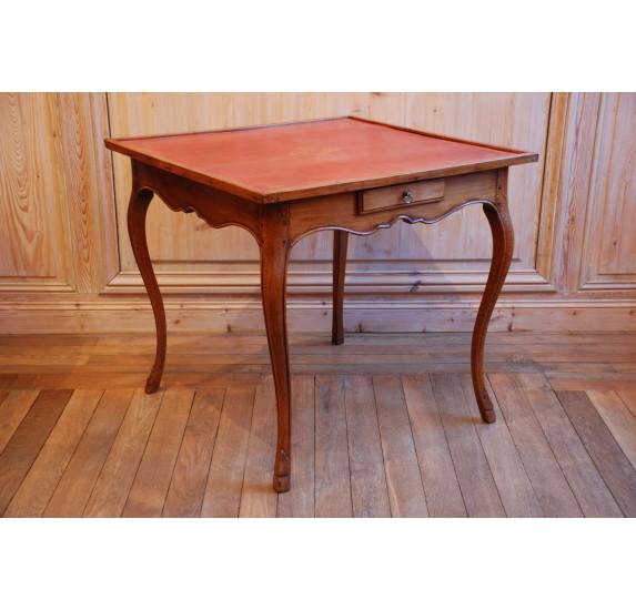 Table de milieu en merisier et cuir rouge